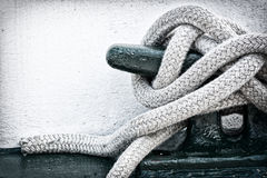 Mooring Line on Cleat. A detailed closeup macro of a rope mooring line fastened to a cleat. Space for copy Royalty Free Stock Images