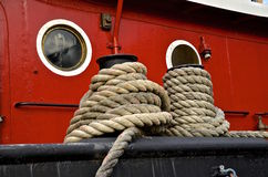 Mooring lines secure a tugboat to a quay Royalty Free Stock Photos