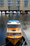 Mooring motorboat on river in the city Royalty Free Stock Photo