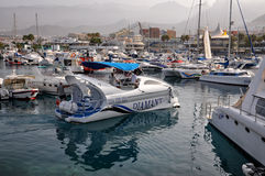 Mooring with motorboat and yachts. TENERIFE, SPAIN- JULY 1, 2011: Mooring with motorboat and yachts Stock Photo
