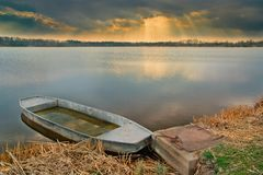 Mooring old small boat a in evening light Royalty Free Stock Images