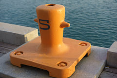 Mooring point for large ship. Orange mooring for a large ship. Nice light at golden hour Stock Images