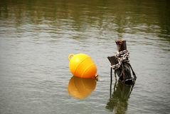 Mooring pole and buoy Stock Photography