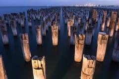 Mooring poles at night at Princes Pier Royalty Free Stock Photography