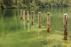Mooring poles at St Bartholoma pier. Konigssee. Germany Royalty Free Stock Photography