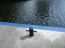 Mooring Post. Here is a mooring at a formal juncture for locks and canals in Smiths Falls Stock Photo