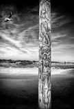 Mooring Post - Norfolk UK. A weathered, heavily grained mooring post on an estuary jetty - Norfolk, UK Royalty Free Stock Photos