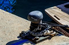 Mooring post on the waterfront in a small marina, element for mo stock images