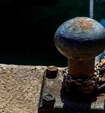 Mooring post on the waterfront in a small marina, element for mo stock photography