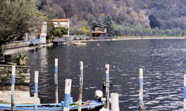 Mooring posts and boats. Royalty Free Stock Photos