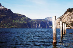 Mooring posts -- Lake Lucerne Switzerland. Mooring posts on the banks of Lake Lucerne, near Fluelen in Switzerland Royalty Free Stock Images