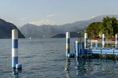 Mooring posts and lake view at Iseo , Italy Stock Photos