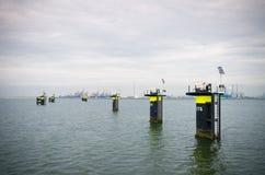 Mooring posts in rotterdam harbor Stock Photography