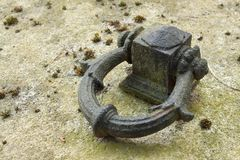 Mooring ring. Old steel ring in a granite countertop. Detailed view of the anchoring point. Royalty Free Stock Images