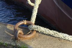 Mooring ring and rope on the quay. stock images