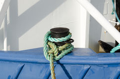 A mooring rope from the boat to land Stock Photos