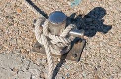 Mooring rope and bollard Stock Photography