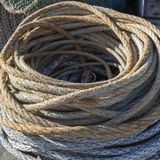Thick Rope. Mooring rope coiled on a boat Royalty Free Stock Images