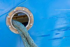 Mooring rope for fishing boat. Burt with a mooring rope stock photography