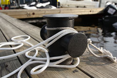 Mooring rope on the pier. Life style royalty free stock photo