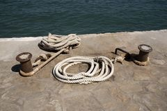 Mooring rope secured to a metal post on a quayside Stock Photo