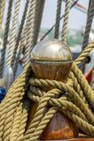 Mooring rope tied on the bollards of old wooden ship Stock Photos