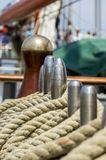 Mooring rope tied on the bollards of old wooden ship Royalty Free Stock Photos