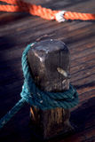 Mooring rope tied to dock Stock Images