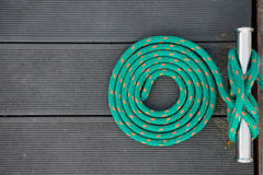 Mooring rope of yacht. Mooring rope in spiral on a pier Royalty Free Stock Images