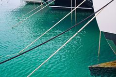 Mooring ropes against Mediterranean gree. N water in the marina of Puerto Portals in Mallorca, Spain Stock Photos
