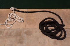 Mooring ropes on jetty Royalty Free Stock Image