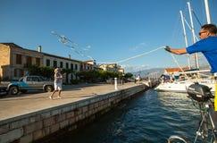 Mooring. Sailors participate in sailing regatta  on Aegean Sea. Royalty Free Stock Images