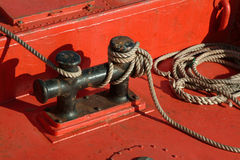 Mooring ship ropes. Mooring red ship and ropes Royalty Free Stock Photography