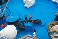 Mooring station on a forward. Anchor windlass mechanism of with rope in ship Stock Images