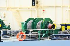 Mooring winch with hawser. Mooring winch mechanism with hawser on ship deck Stock Photos