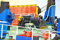 Mooring winch with hawser. Mooring winch mechanism with hawser on ship deck Stock Photography
