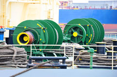 Mooring winch with hawser. Mooring winch mechanism with hawser on ship deck Royalty Free Stock Image