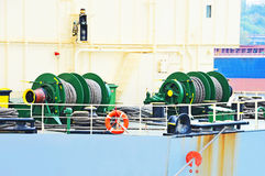 Mooring winch with hawser. Mooring winch mechanism with hawser on ship deck Royalty Free Stock Photography