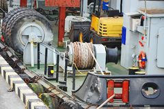 Mooring winch with hawser. Mooring winch mechanism with hawser on floating crane deck Royalty Free Stock Images