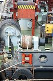 Mooring winch with hawser. Mooring winch mechanism with hawser on floating crane deck Royalty Free Stock Photo