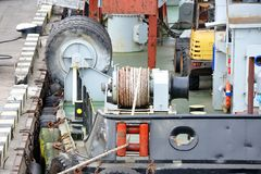 Mooring winch with hawser. Mooring winch mechanism with hawser on floating crane deck Stock Image