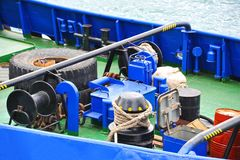 Mooring winch with hawser. Mooring winch mechanism with hawser on ship deck Royalty Free Stock Images