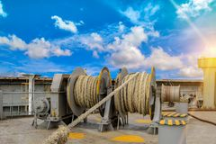 Mooring winch. Es on deck for container ship, forward  rope on blue sky background Stock Image