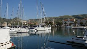 Mooring for yachts near the old town of Trogir. Croatia stock video footage