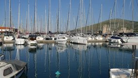 Mooring for yachts near the old town of Trogir. Croatia stock footage