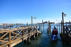 The moorings for the gondolas, the pier for embarking on a romantic trip on the lagoon to Venice, starting from Piazza San Marco. Discovering one of the most stock image