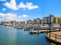 The moorings and luxury houses in harbor Royalty Free Stock Photos