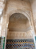 Moorish arch in the Alhambra palaces. An arched decorative doorway with ceramic tiles in the Alhambra Palace, Spain Royalty Free Stock Photography