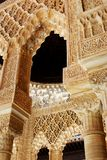 Moorish arches, Alhambra Palace. Marble arches forming the arcades surrounding the court of the Lions (Patio de los leones), Palace of Alhambra, Granada Royalty Free Stock Photo