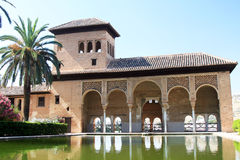 Moorish Architecture in The Alhambra. Reflecting pool and building in the Alhambra, Grenada, Spain stock photos